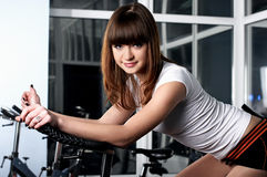 The young charming girl in a sports hall Stock Photos