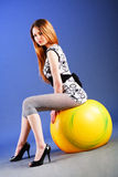 Young charming girl on tunic Stock Photography