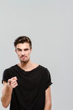 Young charming guy pointing on you Stock Photo