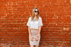 Free Young Charming Hipster Woman In A White Vintage Lace Blouse In Black Sunglasses With A Luxurious Necklace In An Elegant Skirt Royalty Free Stock Photo - 139127745