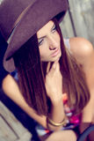 Young charming lady in pale purple hat looking at Stock Image