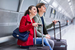Young charming passengers with luggage waiting for train Royalty Free Stock Photography