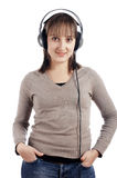 The young charming smiling girl listens to music i Royalty Free Stock Image