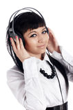 The young charming smiling girl listens to music i Stock Photo