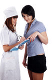 The young charming staff nurse with  patient Royalty Free Stock Photography