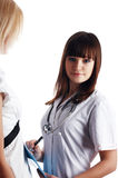 The young charming staff nurse with  patient Royalty Free Stock Photo