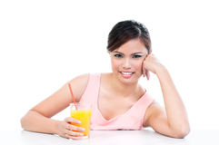 Young charming woman holding orange juice Stock Photos