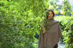 Young charming woman in the Park among the green trees. Walking. Stock Photo