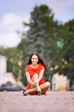 Young charming woman in red dress Royalty Free Stock Image