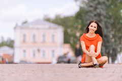 Young charming woman in red dress Stock Photos