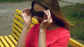 Young charming woman with red lips wears sunglasses stock video