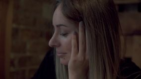 Young charming woman sitting in coffee shop or cafe during free time, attractive female with cute smile having talking. Conversation with somebody while rest in stock footage