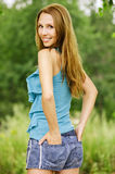 Young charming woman standing back Royalty Free Stock Photos