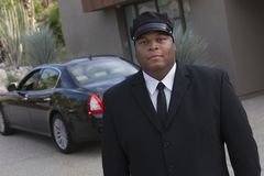 Young Chauffeur In Suit Stock Image