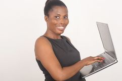 Young cheerful businesswoman with laptop Royalty Free Stock Photo