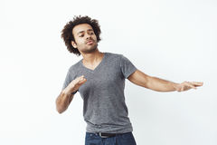 Young cheerful african man moving dancing over white background. Royalty Free Stock Photography