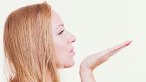 Woman sending air kiss stock images