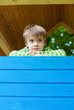 Young cheerful boy inside a blue playhouse Stock Photos