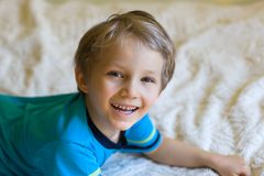 Young cheerful boy laying down Royalty Free Stock Photography