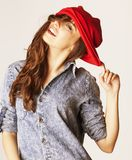 Young cheerful brunette teenage girl on white Stock Image