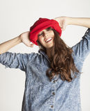 Young cheerful brunette teenage girl on white Royalty Free Stock Photography