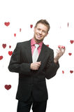 Young cheerful businessman holding red gift Stock Images