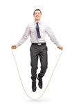 Young cheerful businessman jumping a rope Royalty Free Stock Photo