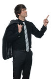 Young cheerful businessman pointing up Stock Images