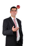 Young cheerful businessman tossing an apple Stock Images