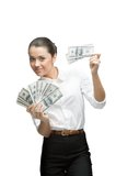 Young cheerful businesswoman holding money Royalty Free Stock Photography