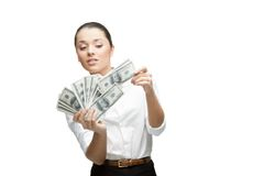 Young cheerful businesswoman holding money Royalty Free Stock Image