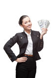 Young cheerful businesswoman holding money Stock Photo