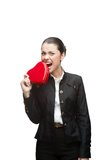 Young cheerful businesswoman holding red heart Stock Photography