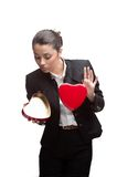 Young cheerful businesswoman holding red heart Stock Photo