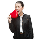 Young cheerful businesswoman holding red heart Stock Photos