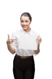 Young cheerful businesswoman holding sign Stock Image