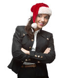 Young cheerful businesswoman in santa hat standing isolated on w Stock Photography
