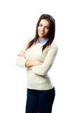 Young cheerful businesswoman standing with arms folded Royalty Free Stock Image