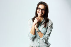 Young cheerful businesswoman wearing glasses standing Stock Photo