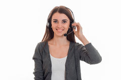 Young cheerful call office girl with headphones isolated on white background in studio Royalty Free Stock Photo