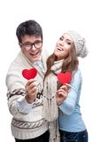 Young Cheerful Casual Couple Holding Red Hearts Royalty Free Stock Photography