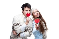 Young cheerful casual couple holding red hearts Stock Photo