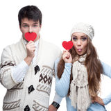 Young cheerful casual couple holding red hearts Stock Image