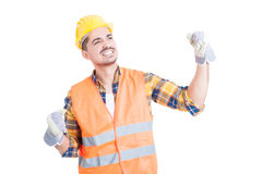 Young cheerful constructor wearing a hardhat and punching the ai Stock Image