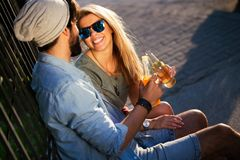 Cheerful couple dating, smiling and talking on summer day. Young and cheerful couple dating, smiling and talking on summer day royalty free stock image