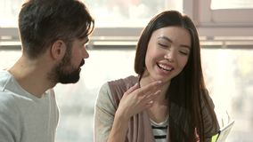 Young cheerful couple having discussion. Happy couple having a great time talking, close up stock video