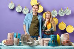 Young cheerful couple having fun in the kicthen room stock image