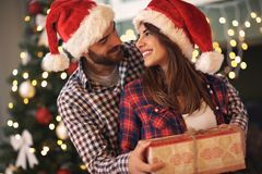 Couple in love with gift for Christmas Stock Images