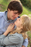 Young cheerful couple in the park Royalty Free Stock Photo
