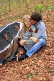 Young cheerful couple in the park Stock Photography